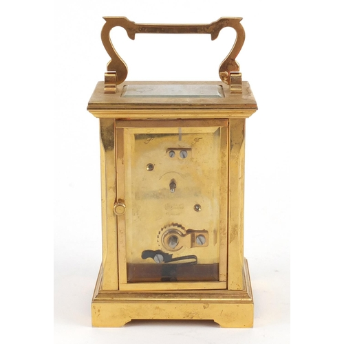 3055 - Garrard & Co brass cased carriage clock with enamelled dial having Roman numerals and box, 12cm high...