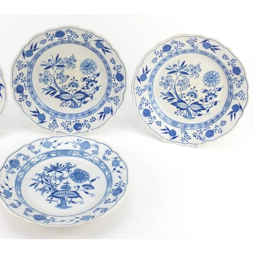 3052 - Four Hutschenreuther porcelain plates, each decorated in the Blue Onion pattern, 26cm in diameter...