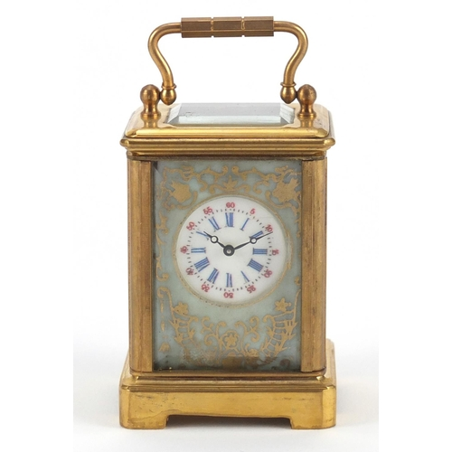 3056 - Miniature brass cased carriage clock with porcelain panels, hand painted and gilded with flowers, 6c...