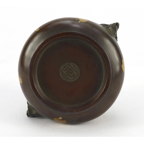3040 - Chinese patinated bronze splashed incense burner with pierced lid and twin handles, impressed marks ...