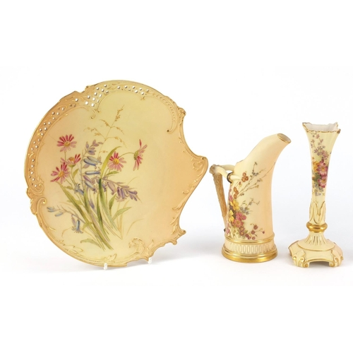3047 - Royal Worcester blush ivory comprising three plates, bud vase and ewer, each decorated with flowers,...