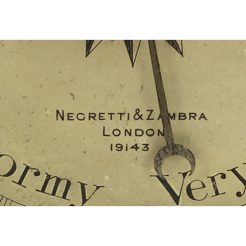 3059 - Negretti & Zambra oak wall barometer with thermometer with silvered dials, numbered 19143, 82cm high...