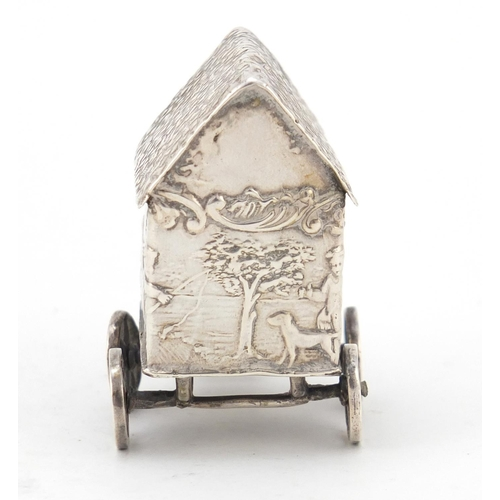 3018 - Victorian silver model of a young figure on a wagon, embossed with Putti playing, indistinct London ...