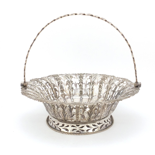 3015 - George II oval silver bread basket with swing handle, by John Langford II and John Sebille, the body...
