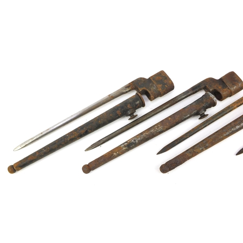 3422 - Four British military socket bayonets, three with scabbards, each 27.5cm in length...
