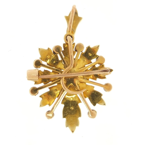 4123 - Unmarked gold seed pearl flower head pendant, 3.6cm in length, 5.6g...