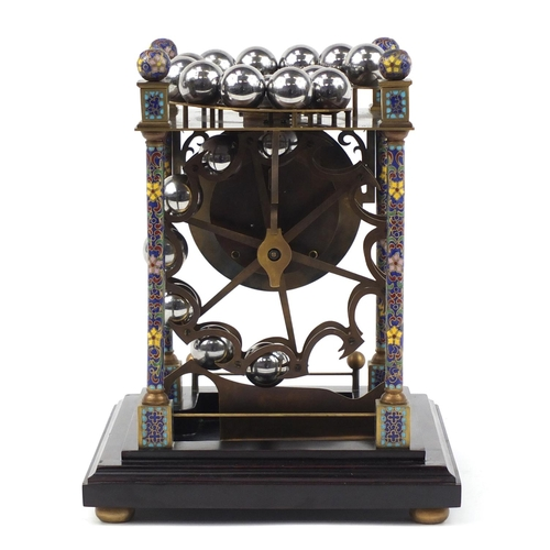 3058 - Champlevé enamel rolling-ball clock with enamel dial, having Roman numerals and glass case, overall ...