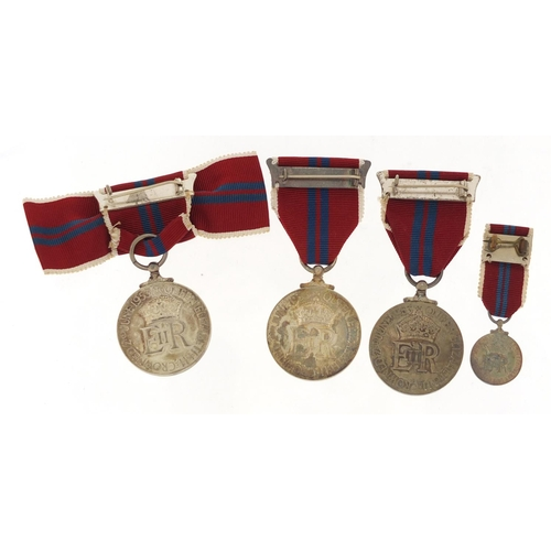 3317 - Three Elizabeth II 1953 coronation medals and a miniature with boxes including a ladies issue...