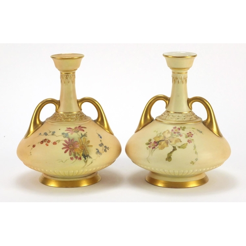 3045 - Pair of Royal Worcester blush ivory vases with twin  handles, each decorated with flowers, numbered ...