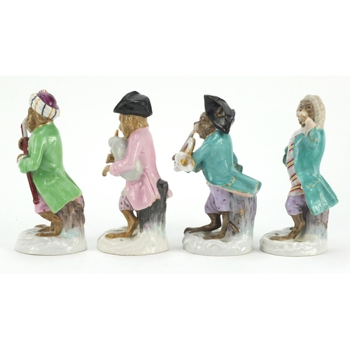 3049 - Eleven German porcelain monkey band figures in the style of Meissen, each with blue under glaze mark...