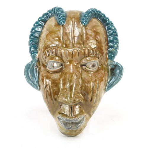 3646 - Continental Art Deco pottery face mask of a tribesman, indistinctly inscribed Mafoud Bemanol? to the...