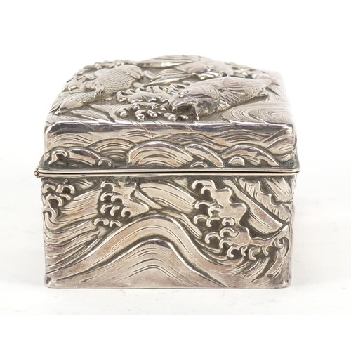 3036 - Good Japanese double skin silver box, the hinged lid and body profusely embossed with three fish amo...