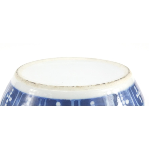 3042 - Pair of Chinese blue and white porcelain jars and covers raised on hardwood stands, each hand painte...