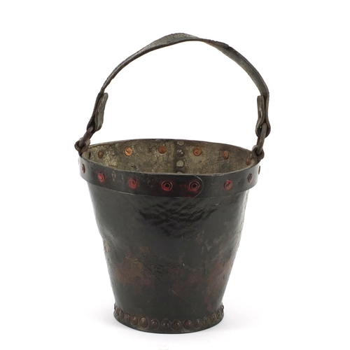 3175 - Antique leather fire bucket with metal rim and remnants of paint, 27cm high excluding the handle...