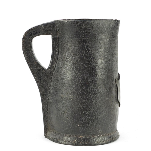 3001 - Large 17th century leather Black Jack jug with pewter cartouche engraved AF and dated 1671, 23.5cm h...