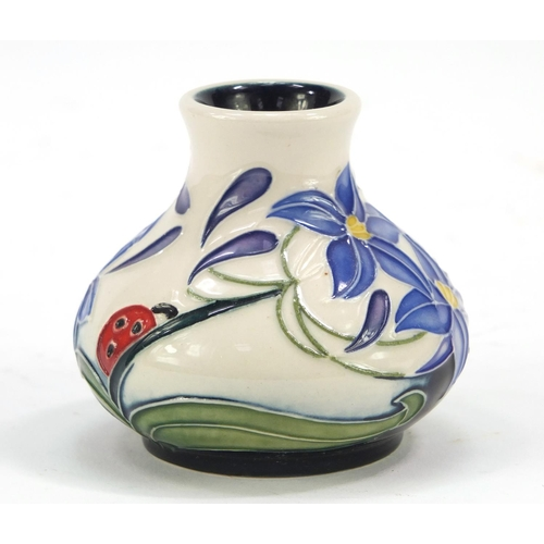 421 - Moorcroft pottery vase hand painted with a ladybird and flowers, dated 2005, 6cm high