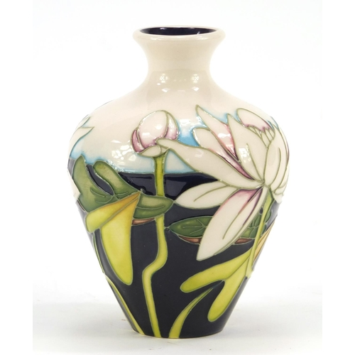 420 - Moorcroft pottery vase hand painted with lilies, dated 2012, 10.5cm high...