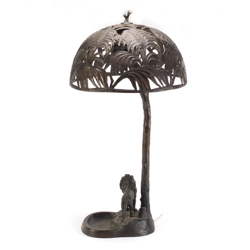 40 - Otto Kainz Austrian bronze table lamp with a lion standing under a pierced tree shade, impressed 'Au...