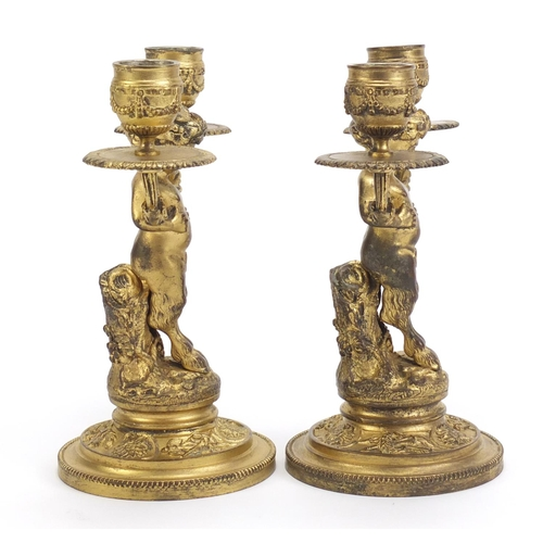 44 - Pair of gilt bronze pan design two branch candlesticks, each 19.5cm high...
