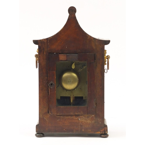 38 - Regency mahogany pagoda topped bracket clock with inset brass panel to the front, flower head design...