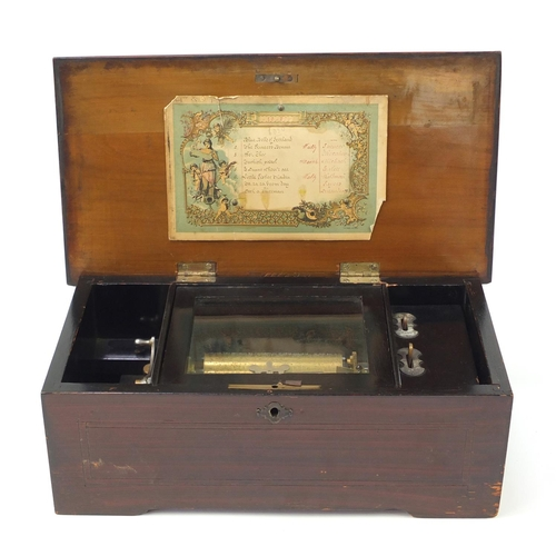 84 - Victorian wooden musical box with rosewood floral inlaid top, playing on eight airs including Little...