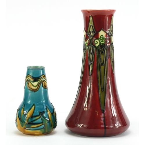 18 - Minton Secessionist pottery comprising two vases and a plate, the vases numbered 1 and 42, the large...