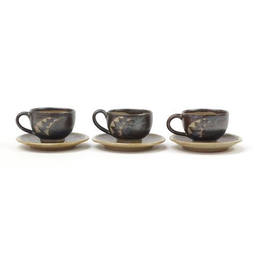 22 - Chris Lewis set of six South Heighton studio pottery cups with sauces, each hand painted with an abs...