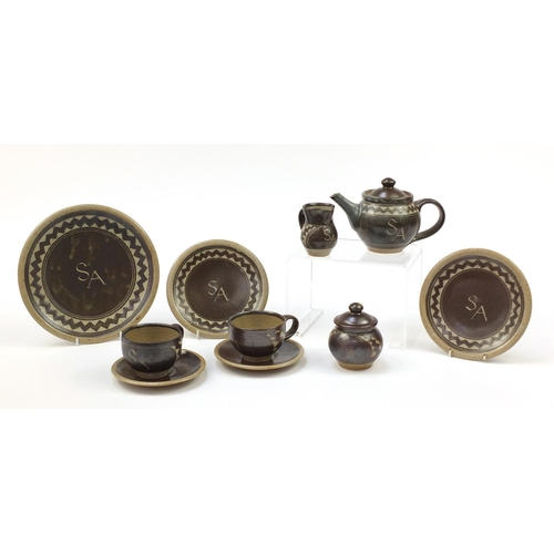 21 - Chris Lewis South Heighton studio pottery tea for two including a teapot, each hand painted with an ...