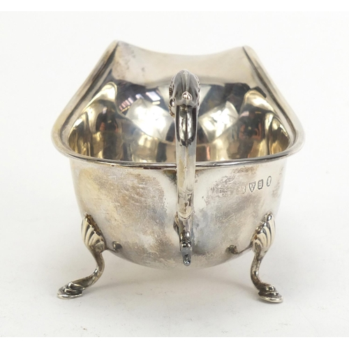 47 - George VI silver sauce boat, indistinct makers mark Chester 1934, 15cm in length, 96.3g...