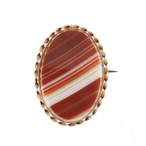 144 - Unmarked gold agate brooch, 3.6cm in length, 10.2g...