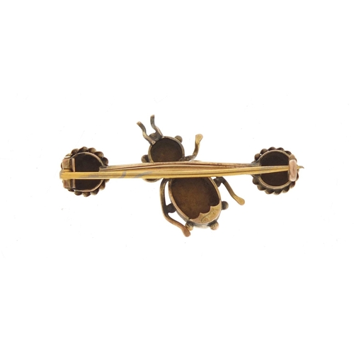 56 - 12ct gold and tiger's eye insect brooch, 4cm in length, 4.2g...