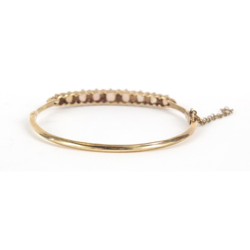 23 - 9ct gold opal and diamond bangle, housed in an Oswing & Co box, 6cm in diameter, 9.2g...
