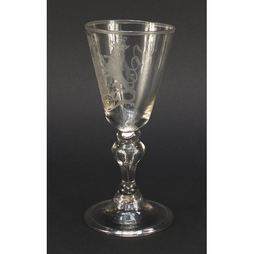 1 - 17th/18th century wine glass engraved with a coat of arms, having a baluster stem enclosing a tear a...