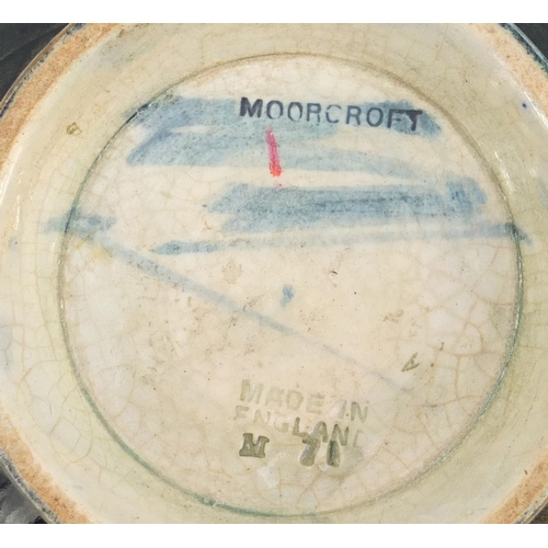 20 - William Moorcroft pottery footed bowl hand painted in the Eventide pattern, 13cm in diameter...