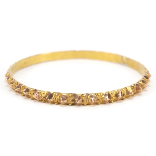 48 - Unmarked gold bangle, (tests as 9ct gold) 6.5cm in diameter, 18.4g...