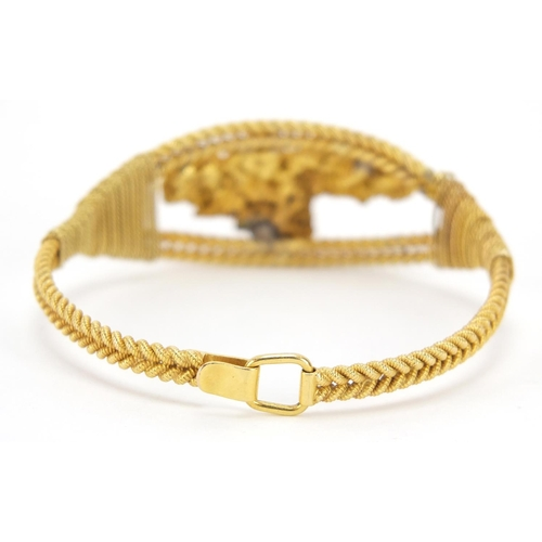16 - Unmarked gold rope twist and gold nugget bracelet, (tests as 18ct gold+) 6cm in diameter, 40.4g...