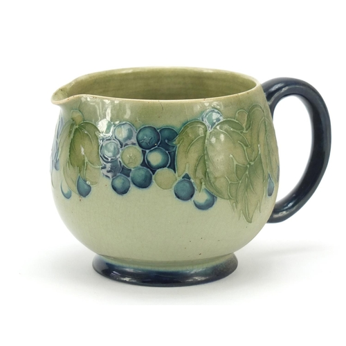 2 - William Moorcroft pottery jug hand painted with leaf and berries, 7.5cm high...