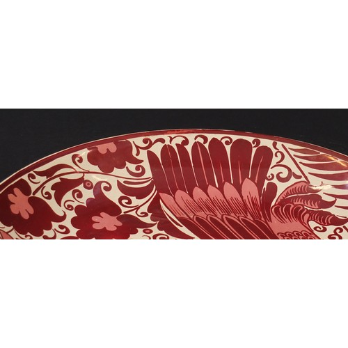 16 - Arts & Crafts ruby lustre charger by William de Morgan, hand painted with a stylised bird, impressed...