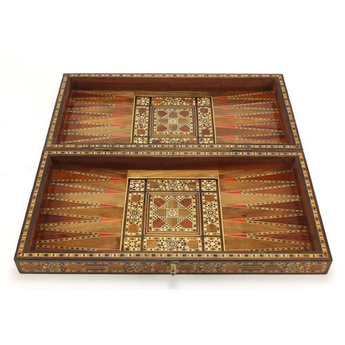 902 - Moorish style Syrian inlaid folding games board with draughts, 50cm x 50cm...