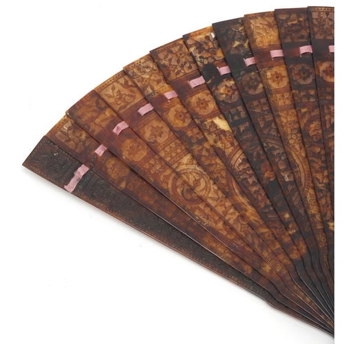 14 - Chinese Canton tortoiseshell brisé fan, finely carved with panels of pagodas amongst flowers and bir...