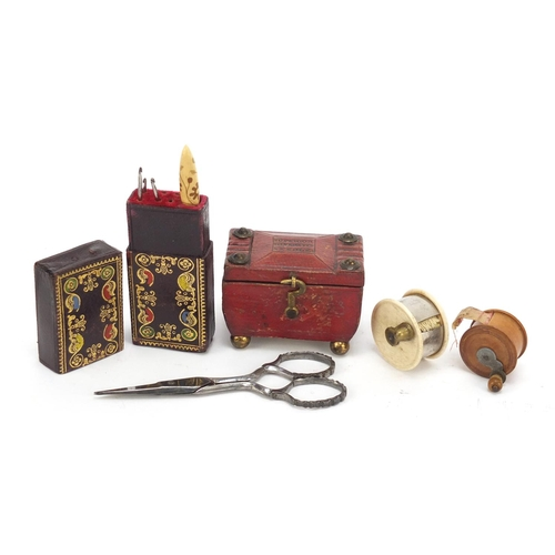 39 - 19th century sewing items comprising a tooled leather needle case in the form of a tea caddy, ivory ...