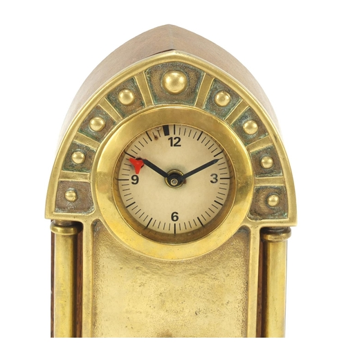 130 - Oak and brass Secessionist mantle clock with columns and Arabic numerals, 23cm high...