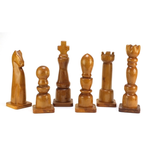 901 - Six oversized carved wood chess pieces, the largest 38cm high...