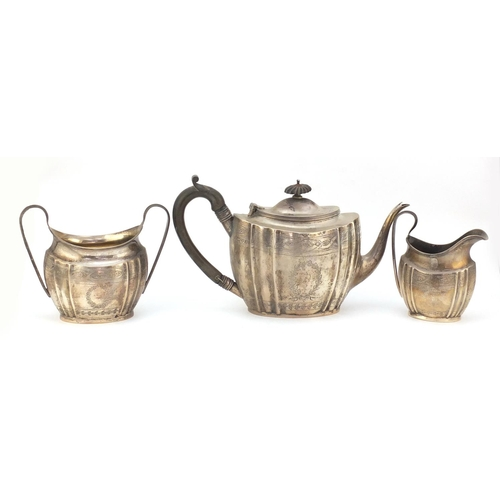 22 - Edward VII silver three piece tea set by George Nathan and Ridley Hayes, Chester 1910, the teapot 16...