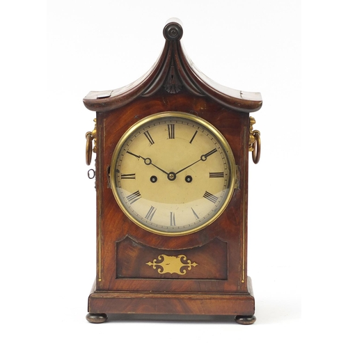 34 - Regency mahogany pagoda topped bracket clock with inset brass panel to the front, flower head design...