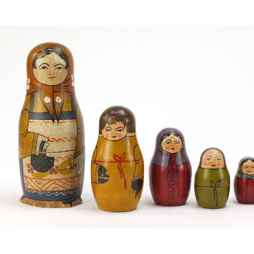 44 - Early Russian Matryoshka hand painted stacking doll comprising twelve inter-fitting dolls, the large...