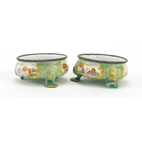 44 - Pair of 19th century French enamel salts, hand painted with panels of farm and landscape scenes, 7cm...