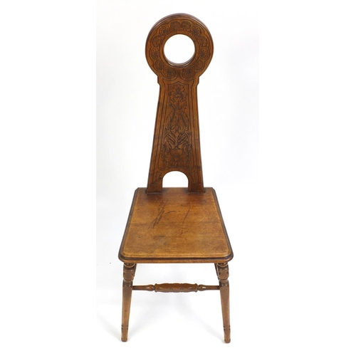 1396 - Arts & Crafts mahogany hall chair with stylised tree and floral carved back, 108cm high...