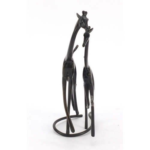 8 - Modernist patinated bronze of two giraffes in the style of Karl Hagenauer, 21cm high...