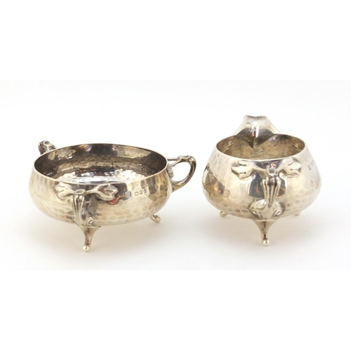 18 - Northern Goldsmith Company, Arts & Crafts planished silver milk jug and sugar bowl, London 1901, the...